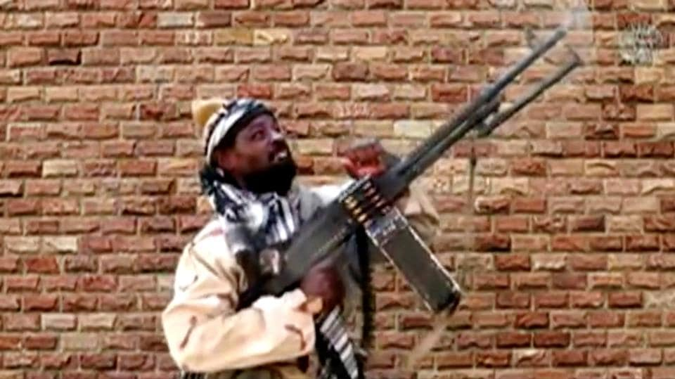 Leader of one of the Boko Haram group's factions, Abubakar Shekau fires from a weapon in an unknown location in Nigeria in this still image taken from an undated video obtained on January 15, 2018.