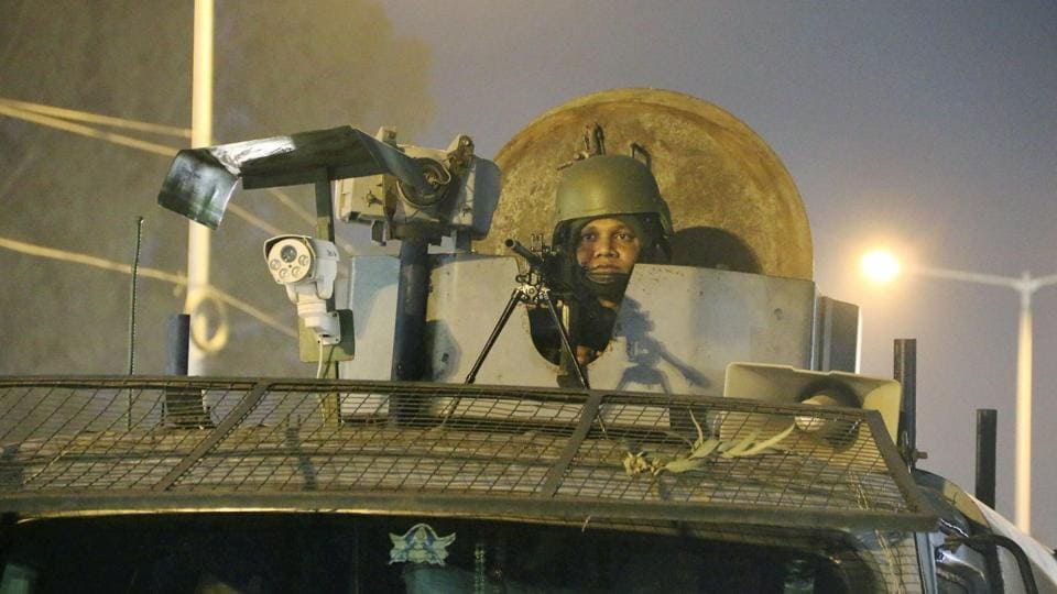 A security personnel guards the Sunjuwan military station in Jammu on Sunday.
