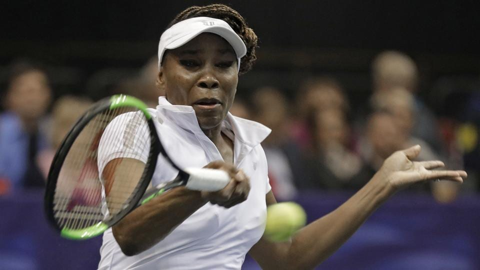 USA's Venus Williams hits a return to Netherlands' Arnatxa Rus during their Fed Cup tennis match on Saturday.