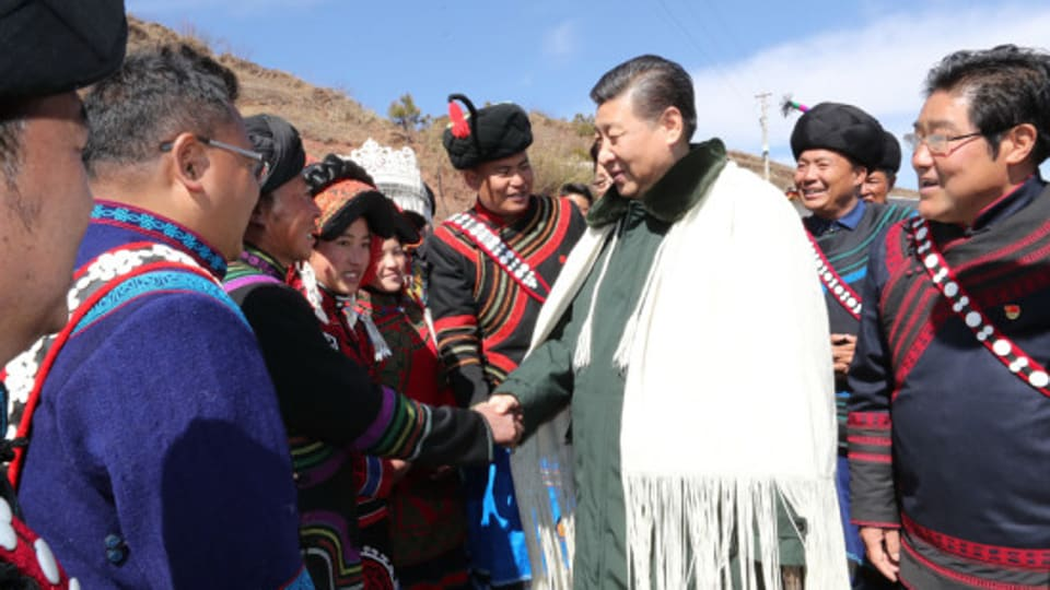 President Xi Jinping seen wearing a white cloak called the chaerwa, a hand-sewn woollen poncho-like mantle, while meeting members of the Yi ethnic group.