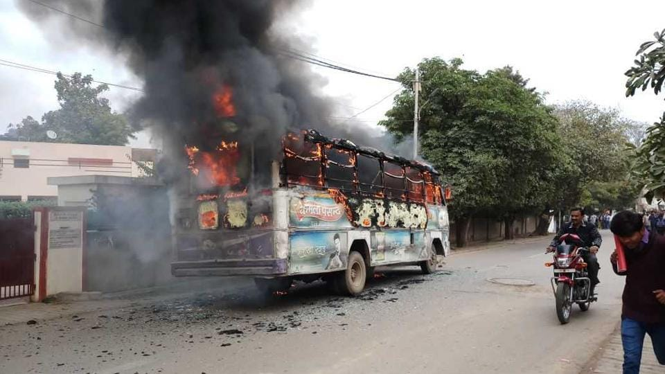 A bus was set on fire at Bank Road in Allahabad on Monday by protesters demanding the arrest of those involved in the attack on a Dalit student.