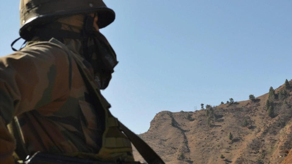 An army jawan keeps vigil at the Indian forward posts along the LoC in Jammu and Kashmir's Poonch district.