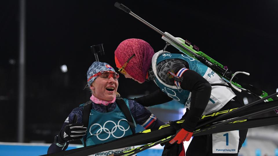 Gold winner Germany's Laura Dahlmeier congratulates silver winner Slovakia's Anastasiya Kuzmina after she crosses the finish line in the women's 10km pursuit biathlon event during the Pyeongchang 2018 Winter Olympic Games on Monday. (AFP)