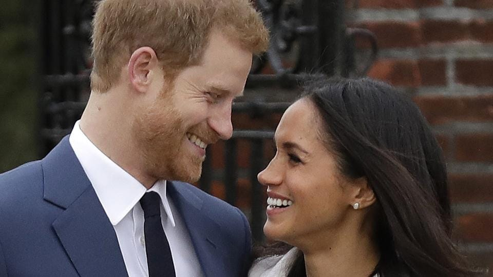 Britain's Prince Harry and his fiancee Meghan Markle pose for photographers in the grounds of Kensington Palace in London, following the announcement of their engagement.