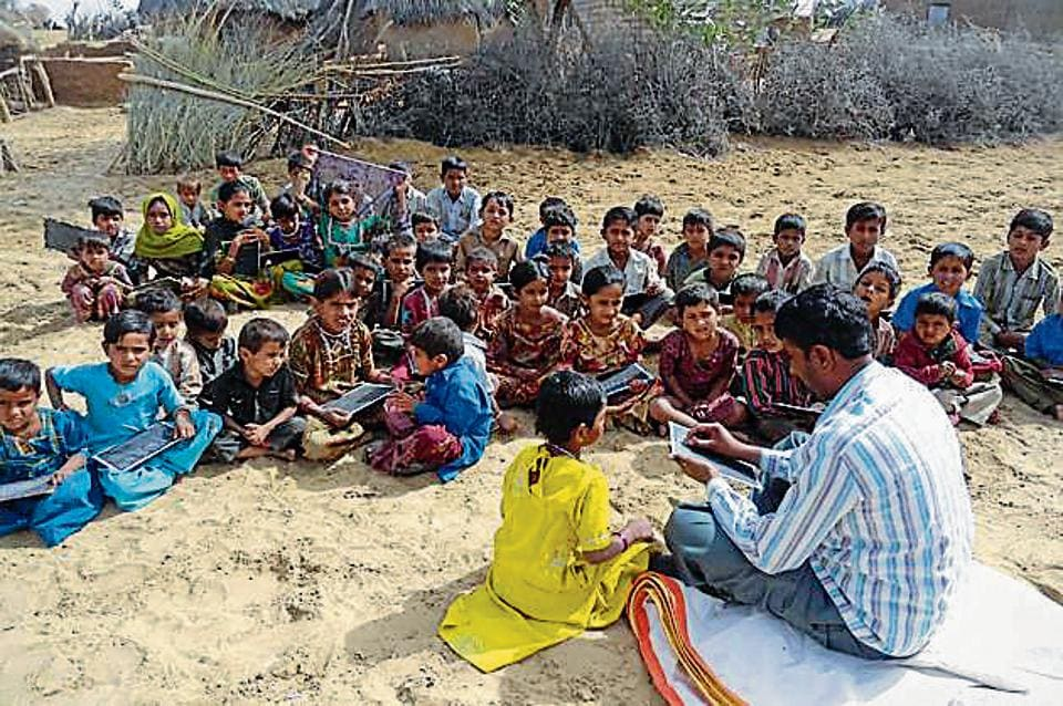 Children study in the open at a school in Barmer district.  The recent report of Pratham, an NGO working in the education sector,  states that the learning levels of students in areas, such as arithmetic and basic reading, are low.