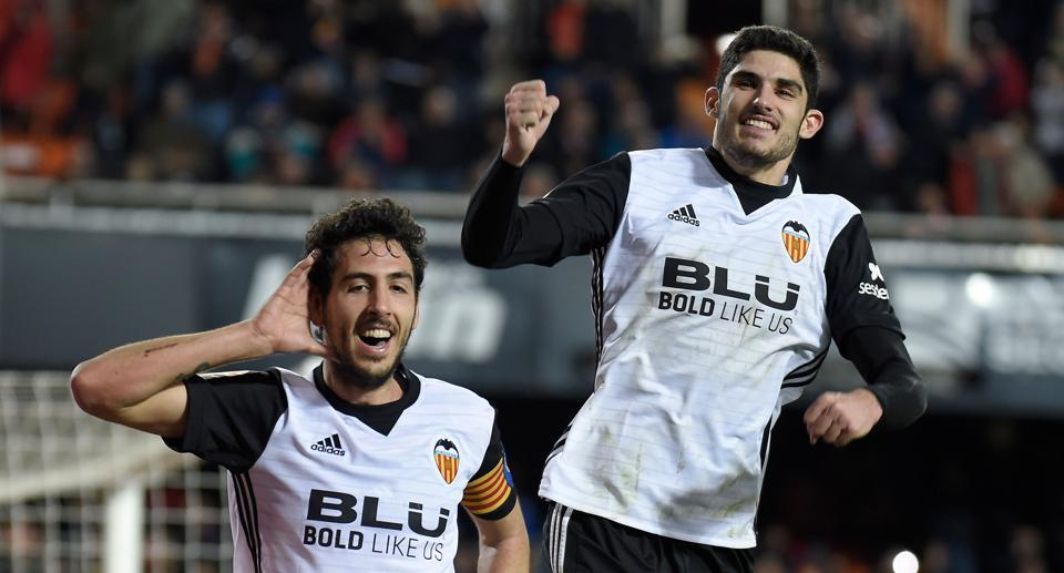 Valencia's midfielder Dani Parejo (L) celebrates with midfielder Manuel Guedes after scoring during the Spanish La Liga match against Levante at the Mestalla stadium on Sunday.
