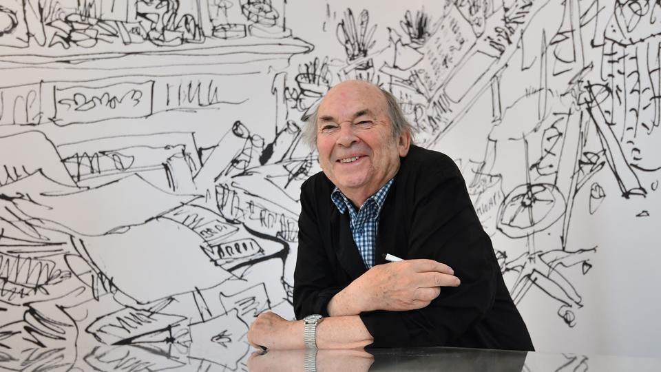 British cartoonist and illustrator, Quentin Blake, poses for photographers during the press preview of his exhibition 'Quentin Blake's Inside Stories' at the House of Illustration in London on July 1, 2014.