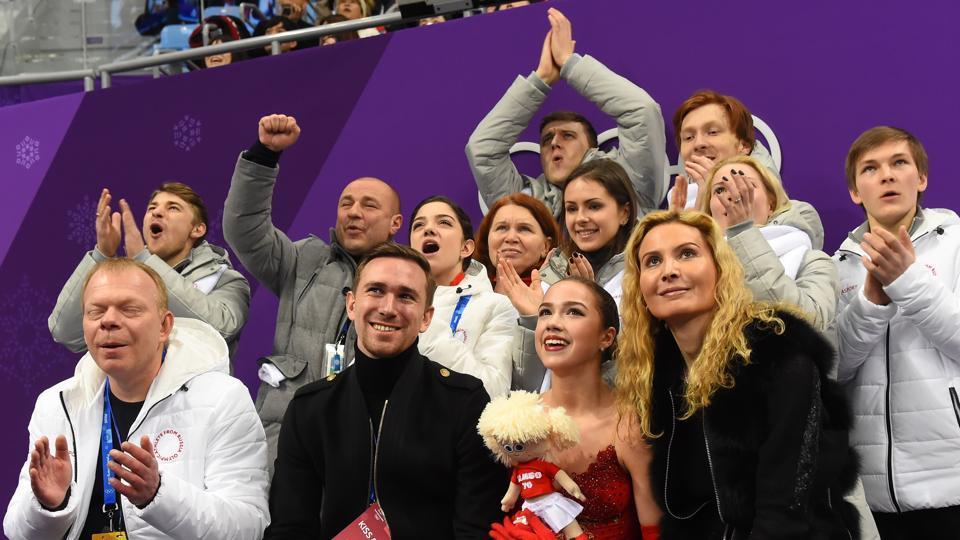 Russia's Alina Zagitova (front 2nd R) reacts after competing in the figure skating team event women's single skating free skating during the Pyeongchang 2018 Winter Olympic Games at the Gangneung Ice Arena in Gangneung on Monday. (AFP)