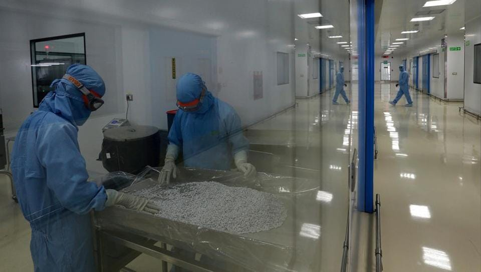 Employees work at the pharmaceutical plant of Lupin in Verna, in the western state of Goa, India.