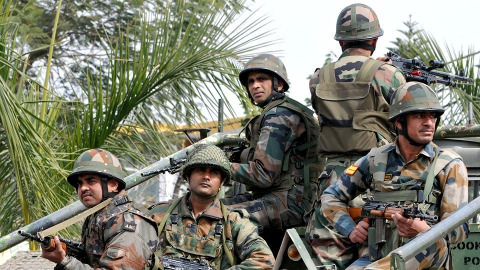 Security personnel take position during an encounter with terrorists at Sunjuwan military station in Jammu on Sunday. Five soldiers and a civilian died in the attack on an army camp.