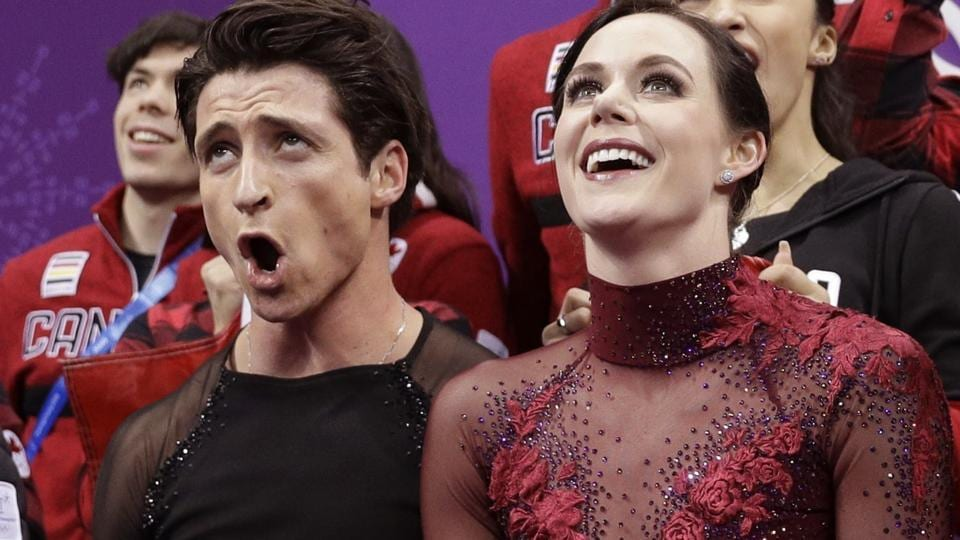 Scott Moir and Tessa Virtue of Canada during the figure skating team event at the Pyeongchang Winter Olympics on Monday.