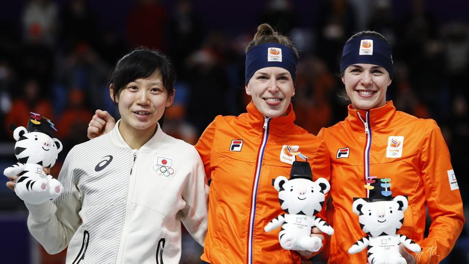 Silver medallist Miho Takagi of Japan, gold medallist Ireen Wust of Netherlands and bronze medallist Marrit Leenstra of The Netherlands pose for photographers after the women's 1,500 meters speedskating race at the Gangneung Oval at the 2018 Winter Olympics in Gangneung, South Korea, on Monday. (AP)