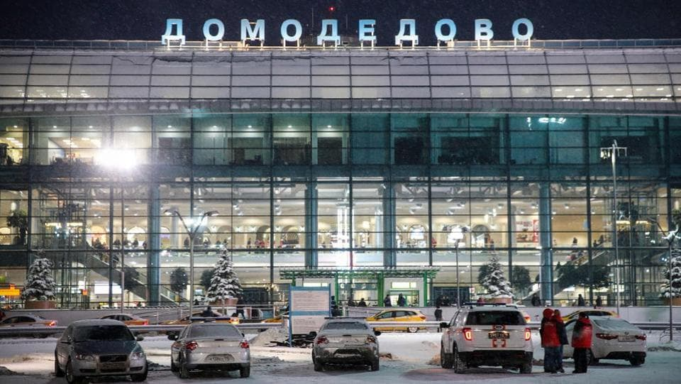Emergency personnel stand next to a vehicle in front of the Domodedovo International Airport. The emergency services ministry said at least one of the two black boxes, which hold flight telemetry information,  had been found and was being analysed. The plane's crew did not send any distress signals. (Maxim Zmeyev / AFP)