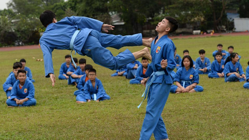 Students from the Research Institute for Vovinam and Sport Development (IVS), a boarding school set up to treat online addictions, practise the martial art at the campus in Ho Chi Minh City.