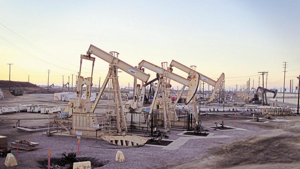 Oil rig pumpjacks extract crude from the Wilmington Field oil deposits near Long Beach, California.