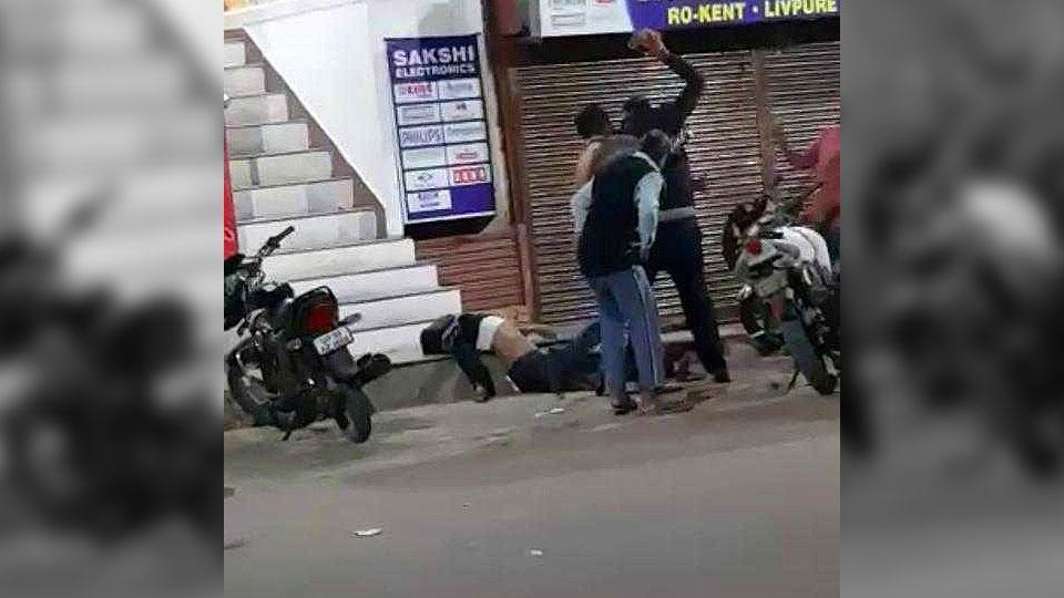 Grabs from a video clipping show the murderous assault on the youth near a restaurant in Katra area of Allahabad.
