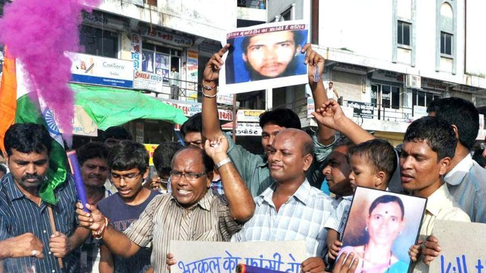 People holding a photo of Indian Mujahideen leader Yasin Bhatkal stage a protest in Ahmedabad.