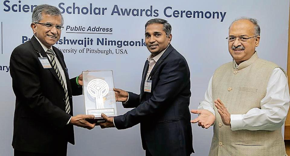 Dr Reddy (second from left) receives the award from Dilip Shanghvi and Prof Vishwajit Nimgaonkar.