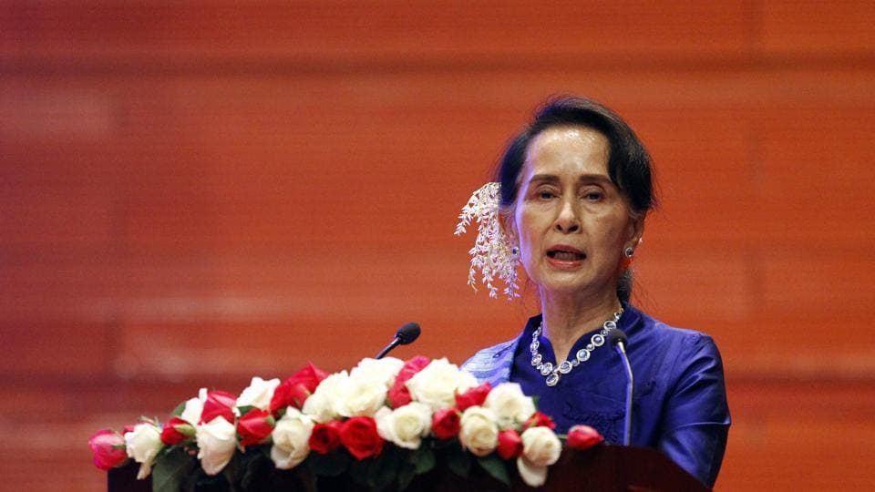 Myanmar's leader Aung San Suu Kyi speaks during the signing ceremony of