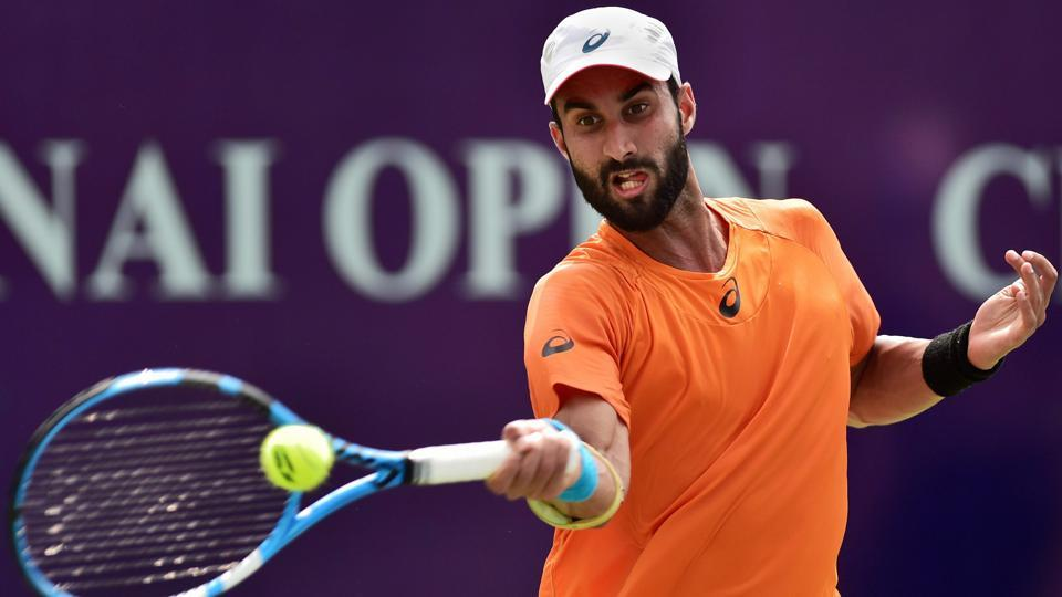 Indian tennis player Yuki Bhambri in action against Bernabe Zapata Miralles of Spain during their first round match of Chennai Open ATP Challenger at SDAT Tennis Stadium in Chennai on Tuesday.