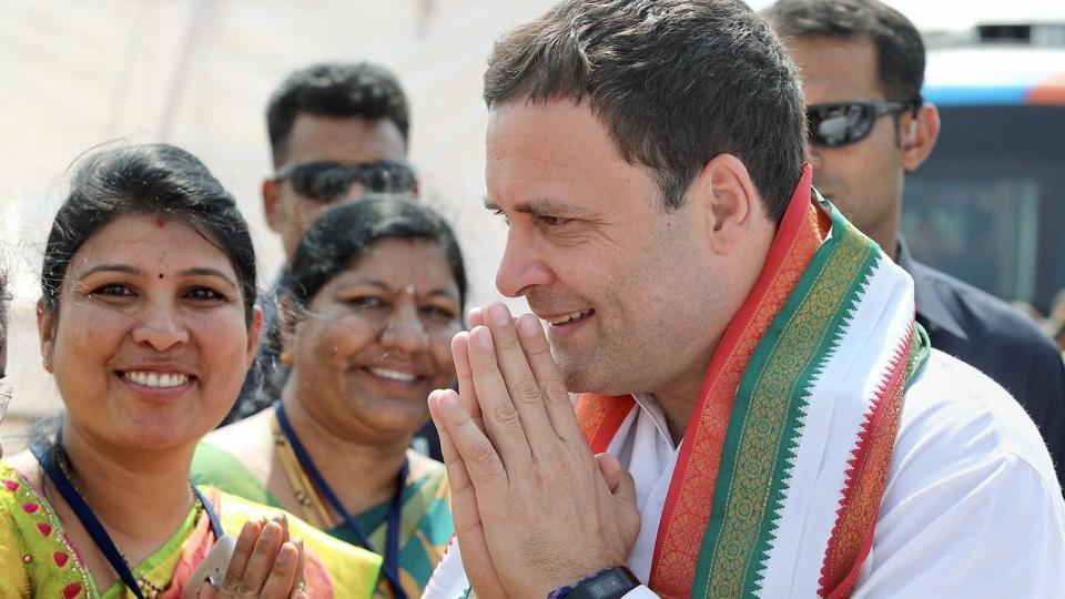 Congress president Rahul Gandhi greets the people during a tribal rally in Raichur on Monday.