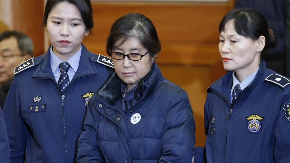 This file photo taken on January 16, 2017 shows Choi Soon-sil (C), the woman at the centre of the South Korean political scandal and long-time friend of President Park Geun-hye, arriving for hearing arguments for South Korean President Park Geun-hye's impeachment trial at the Constitutional Court in Seoul.