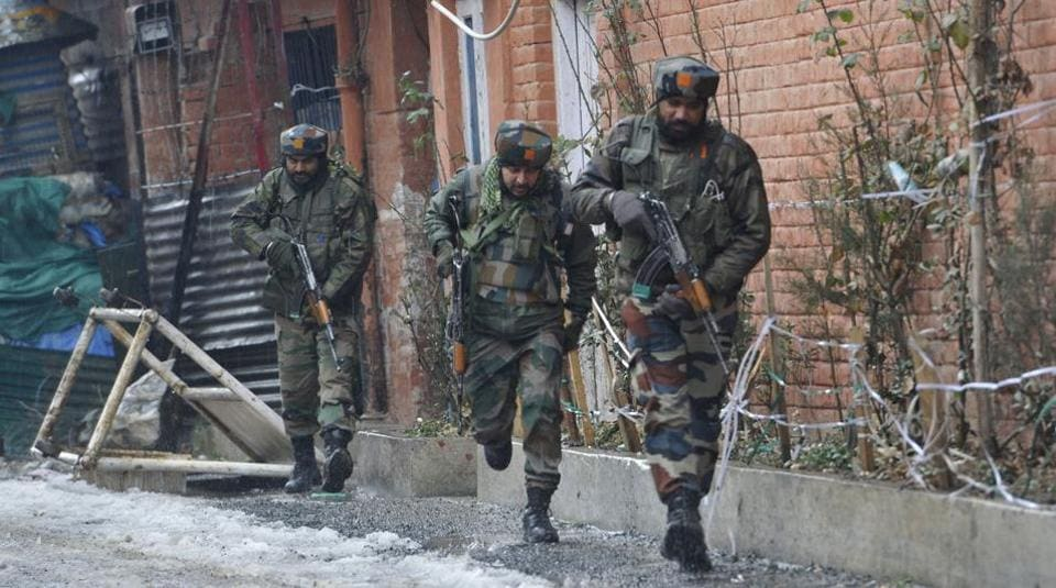 Army personnel take positions during an encounter with the militants, who sought shelter in a building near a CRPF camp at Karan Nagar, in Srinagar, on February 12, 2018.
