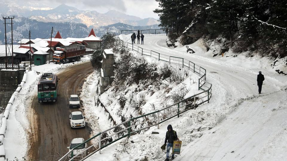 "People walk on a snow-covered road on the outskirts of Shimla. ""The areas are likely to witness more snowfall during next 12 hours,"" said Manmohan Singh, director of the local metrological office. (AFP)"