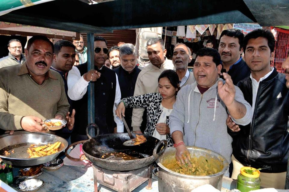 Congress activists frying pakodas at a roadside stall as mark of protest against Prime Minister Narendra Modi's remark