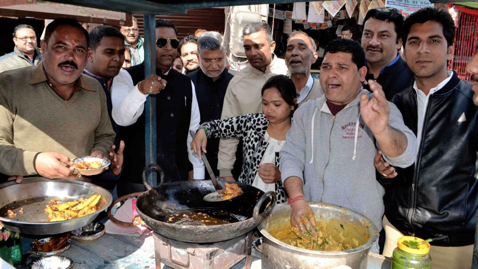 Congress activists frying pakodas at a roadside stall to protest against Prime Minister Narendra Modi's remark equating selling 'pakodas' with employment opportunities, in Haridwar.
