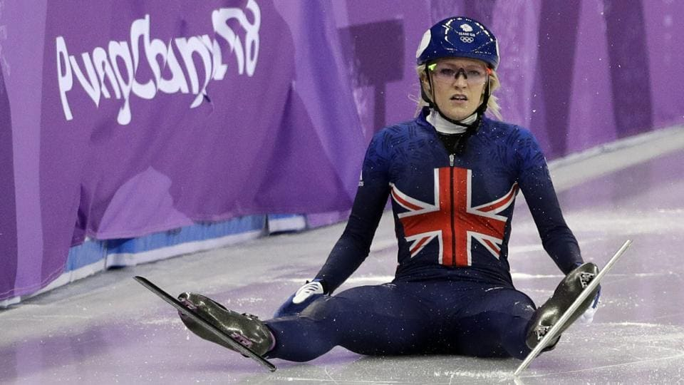 Elise Christie of Britain sits on the ice after crashing during the ladies' 500 meters short track speedskating final in the Gangneung Ice Arena at the 2018 Winter Olympics in Gangneung, South Korea, Tuesday, Feb. 13, 2018.  (AP)