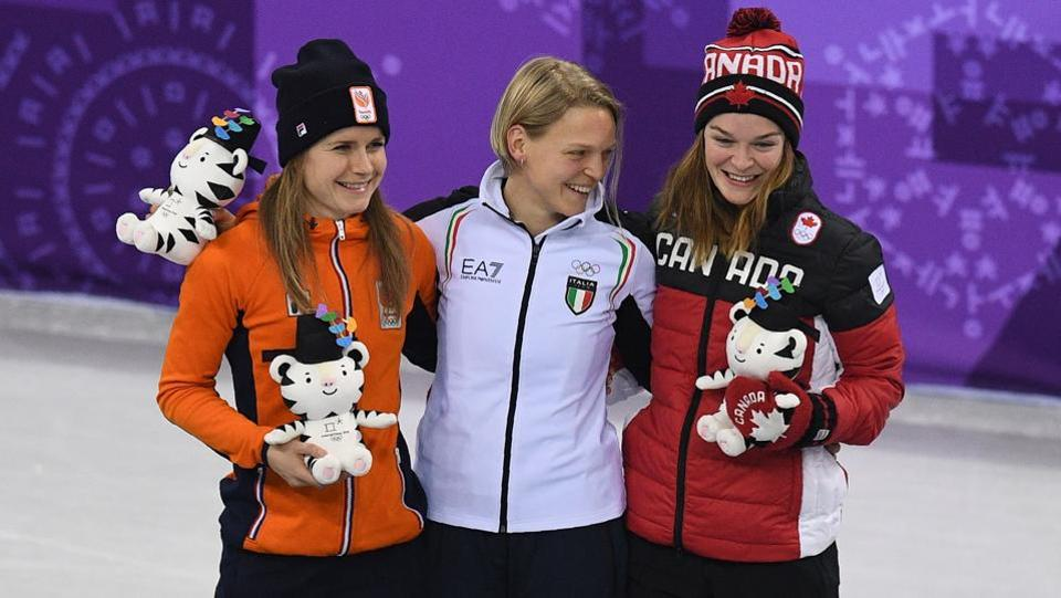 (L-R) Silver medallist Netherlands' Yara van Kerkhof, gold medallist Italy's Arianna Fontana and bronze medallist Canada's Kim Boutin celebrate on the podium after the women's 500m short track speed skating event during the Pyeongchang 2018 Winter Olympic Games, at the Gangneung Ice Arena in Gangneung on February 13, 2018.  (AFP)