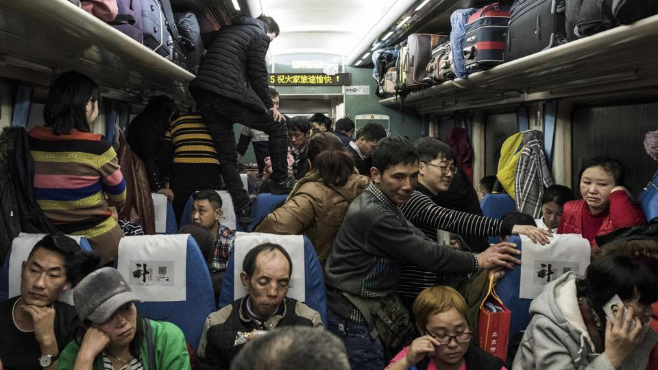 Passengers travel on a crowded train during a 26-hour journey from Beijing to Chengdu ahead of the Lunar New Year. Millions of Chinese have begun heading home from Beijing for the holidays, but many this year will not return as China's capital becomes increasingly unwelcoming for the migrants from the provinces who once powered its economy. (Fred Dufour / AFP)