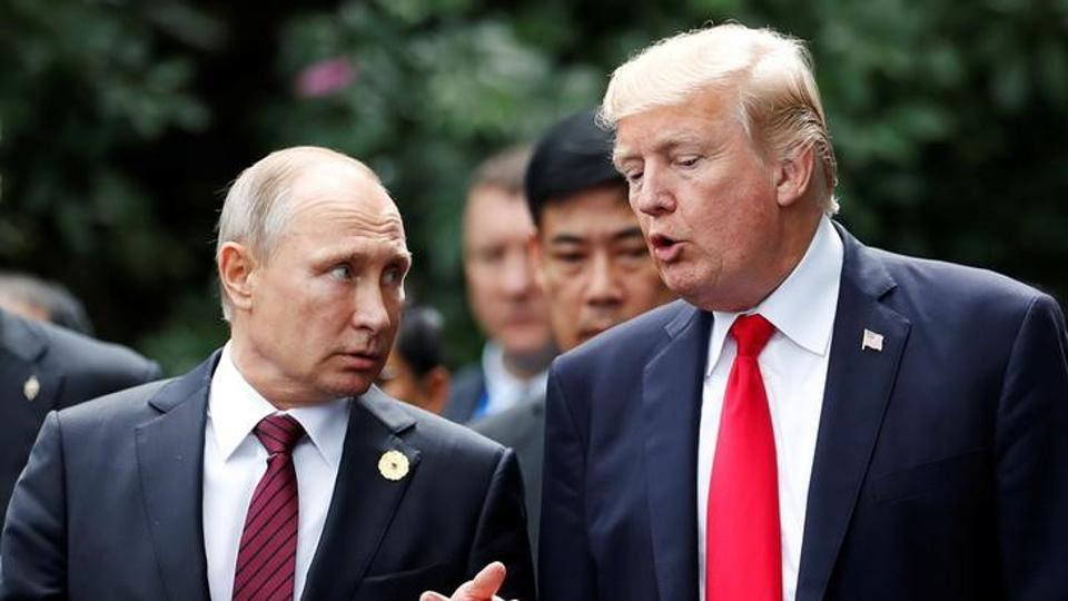 US President Donald Trump and Russia's President Vladimir Putin talk during the family photo session at the APEC Summit in Danang, Vietnam November 11, 2017.