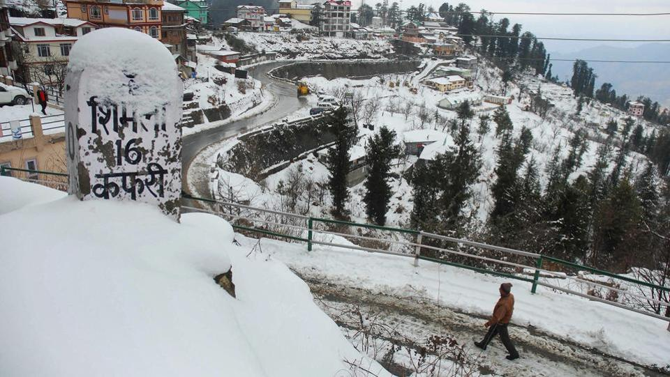 A snow-covered road in Kufri after fresh snowfall near Shimla. Yesterday, Shimla and its nearby areas experienced intermittent spells of rain and snow making it more picturesque. (PTI)