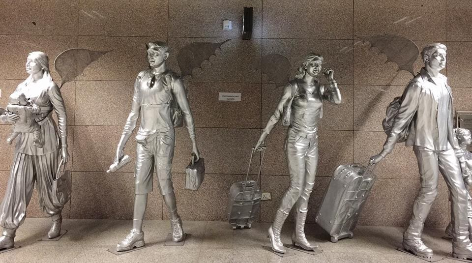 Steel statues at Airport Metro Station.