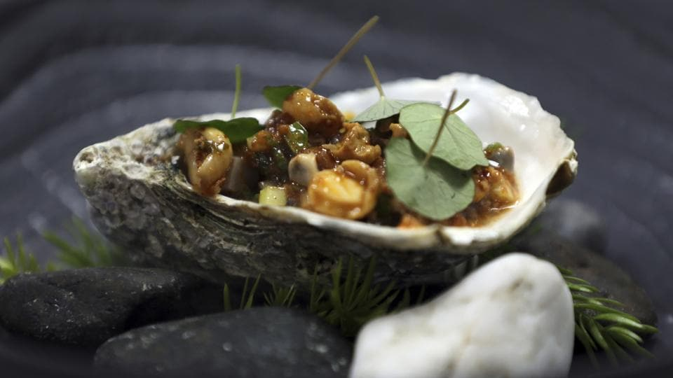 A fresh oyster dish prepared by chef Georgiy Danilov is displayed at Copper Lobster restaurant, in Fairmont, Fujairah, United Arab Emirates.