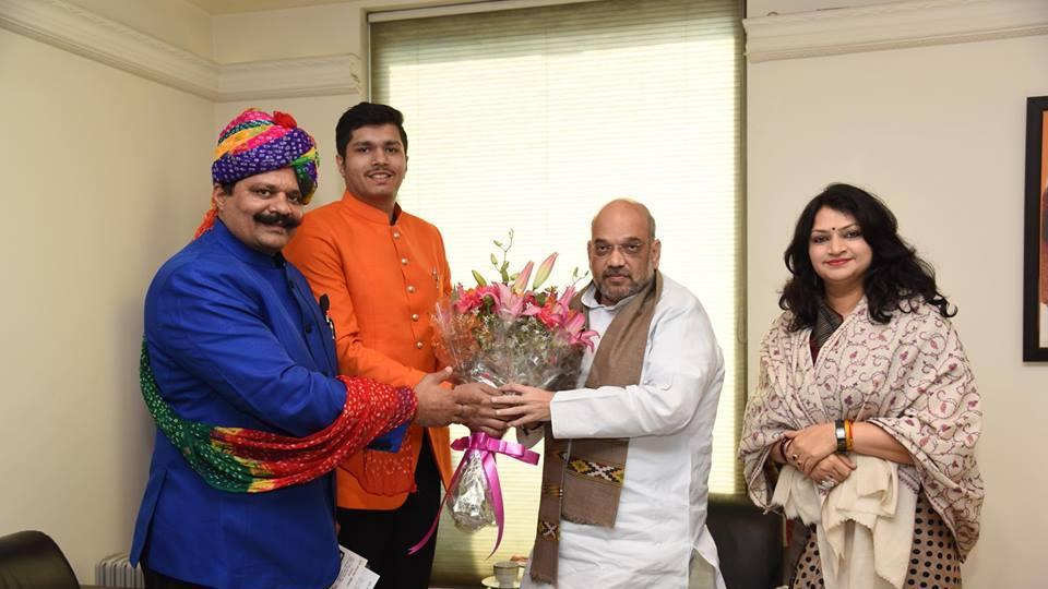 Kunwar Pranav Singh 'Champion' with national BJP president Amit Shah in New Delhi.