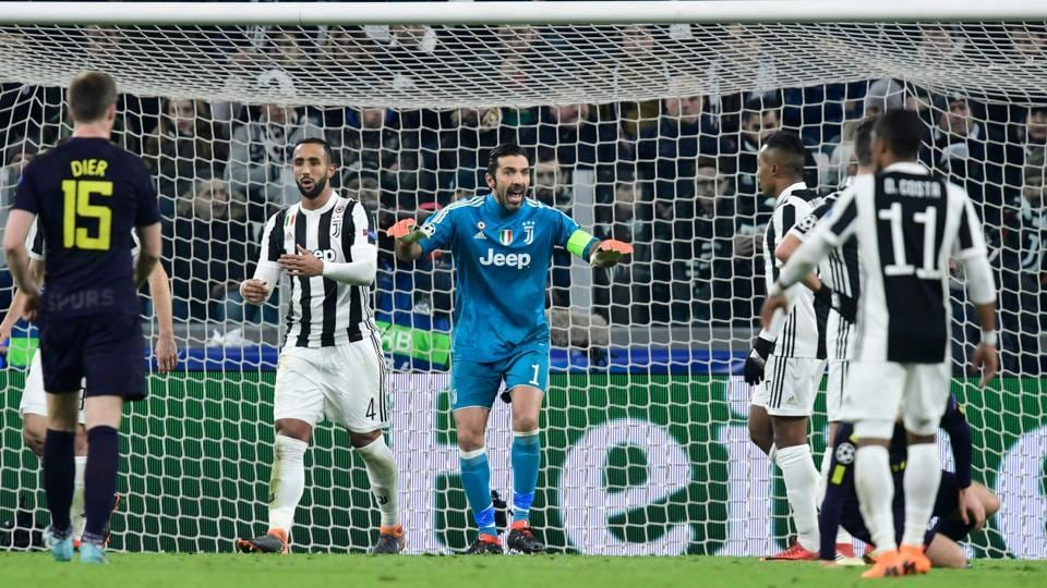 Juventus' goalkeeper from Italy Gianluigi Buffon (C) shouts at his players during the UEFA Champions League round of sixteen first leg football match between against Tottenham Hotspur at The Allianz Stadium in Turin on Tuesday.