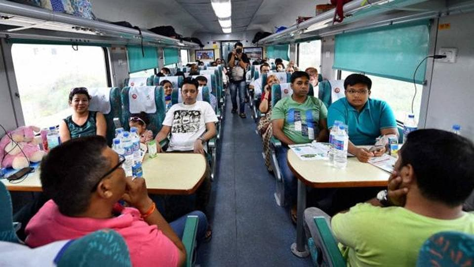 Passengers aboard Gatimaan Express,  India's first semi-high speed train, in New Delhi.