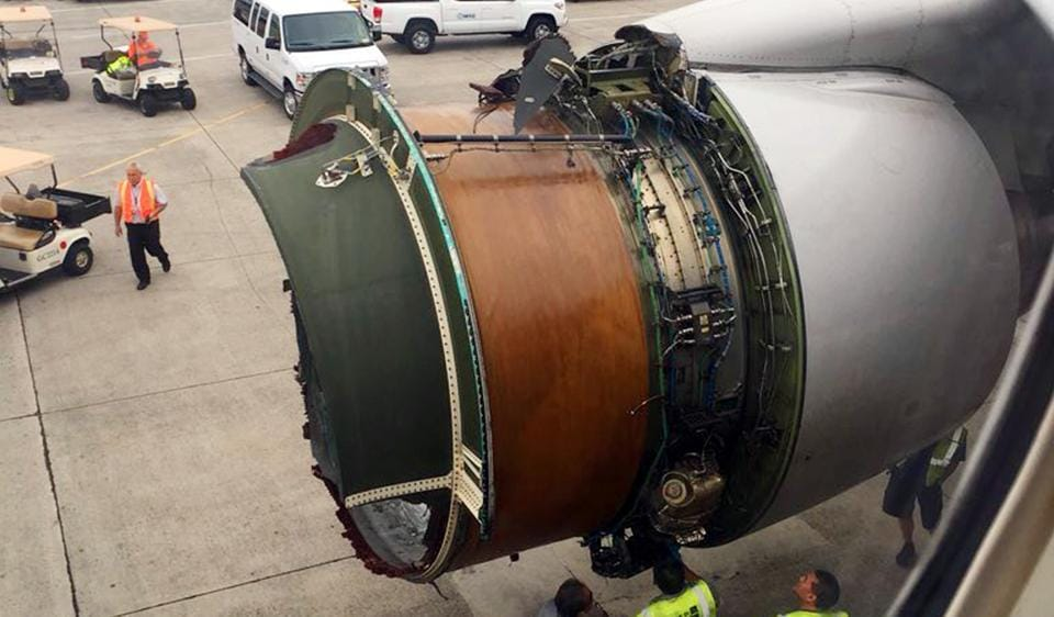 This photo provided by passenger Haley Ebert shows damage to an engine after parts came off the jetliner during its flight from San Francisco to Honolulu.