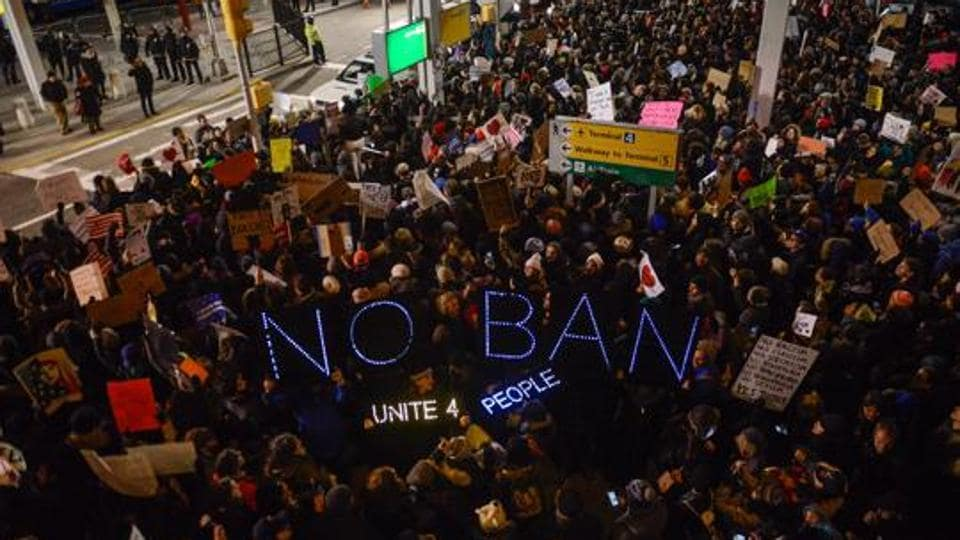 Protesters rally during a demonstration against the Muslim immigration ban at John F. Kennedy International Airport on January 28, 2017 in New York City.