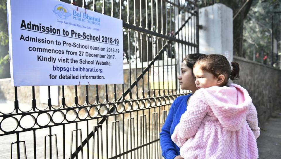 A parent reads a notice on the nursery admissions at Bal Bharti Public School, Pusa Road, in New Delhi.