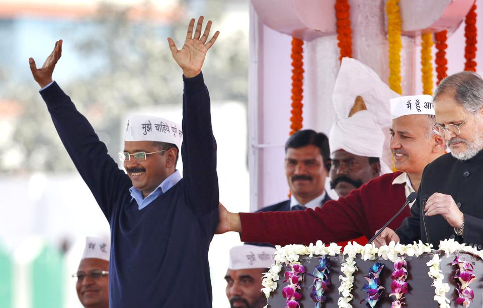 Arvind Kejriwal greets supporters during his swearing-in ceremony as chief minister at the Ramlila ground, New Delhi in 2015. The Aam Aadmi Party's (AAP) slogan 'paanch saal Kejriwal' found such resonance in Delhi that the party ended up rewriting electoral history by winning 67 of 70 assembly seats. As the party completes three years in power today, the new slogan is 'everything is possible'. (Ajay Aggarwal / HT Archive)