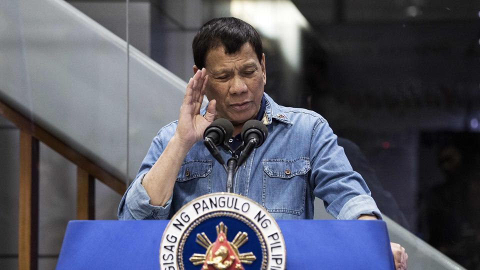 Philippine President Rodrigo Duterte delivers his speech to overseas Filipina workers (OFW) that arrived in Manila from Kuwait are at the Manila International Airport on February 13, 2018.