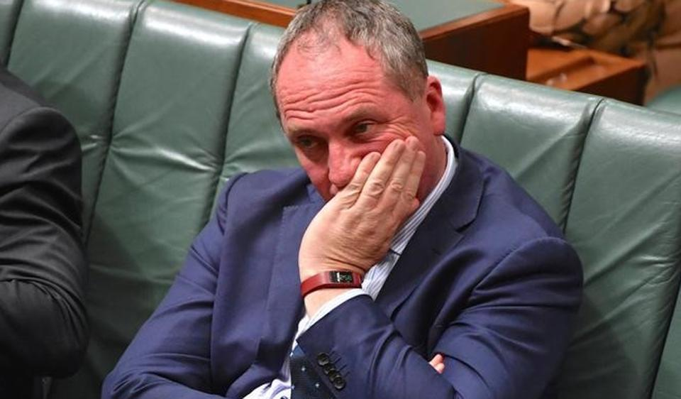 Australian deputy prime minister Barnaby Joyce reacts as he sits in the House of Representatives at Parliament House in Canberra.