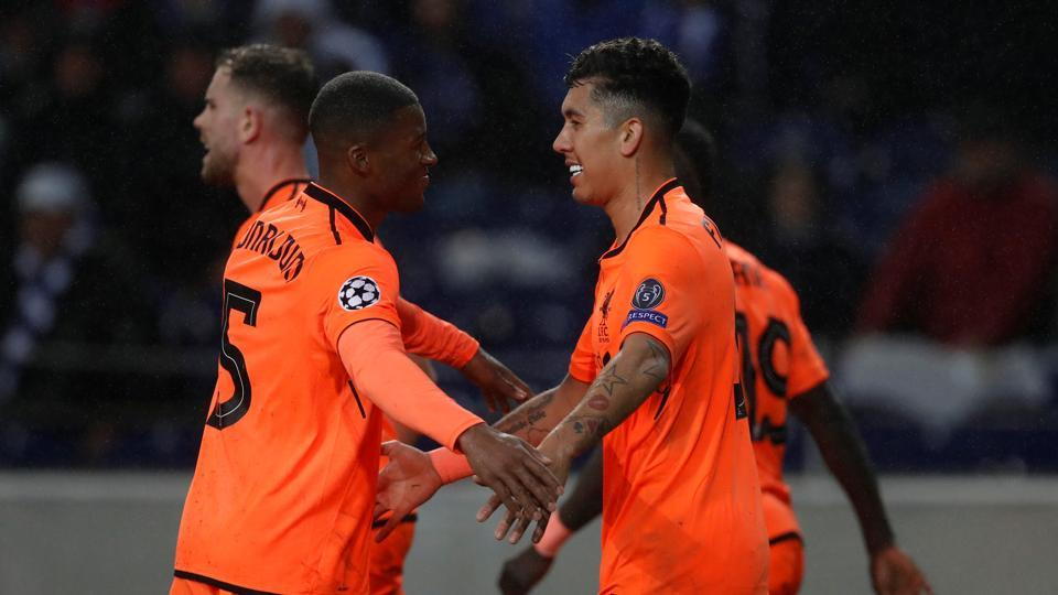 Liverpool's Roberto Firmino celebrates scoring their fourth goal against FC Porto in an UEFAChampions League round of 16 match.