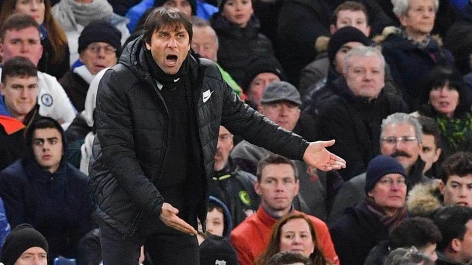 Chelsea coach Antonio Conte's press conference saw a prankster hand him a Manchester United shirt signed by Jose Mourinho.
