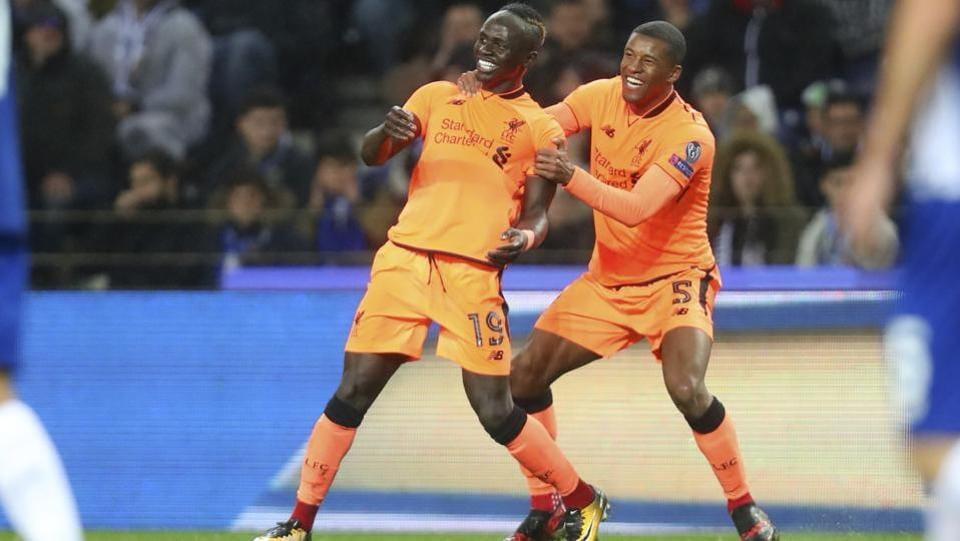 Liverpool's Sadio Mane, left, celebrates with Georginio Wijnaldum after scoring the opening goal during the UEFAChampions League round of sixteen match against FC Porto.