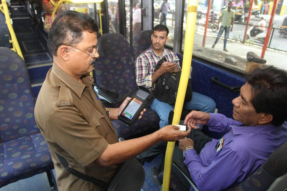 A TMT conductor uses a new machine to give a ticket on the spot